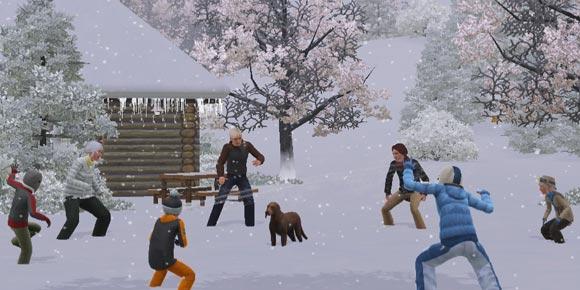 Familie bei der Schneeballschlacht